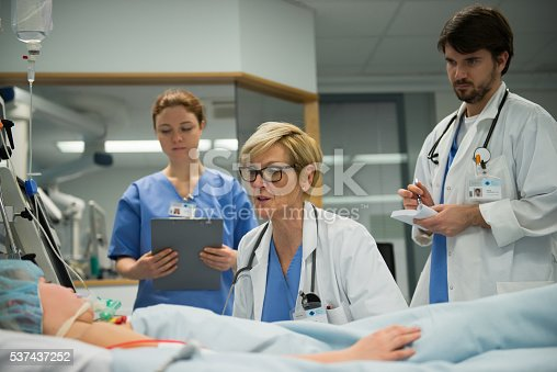 istock Doctor talking with patient 537437252