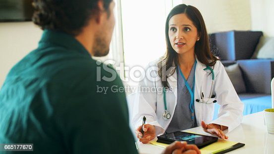 istock Doctor Talking with Patient 665177670