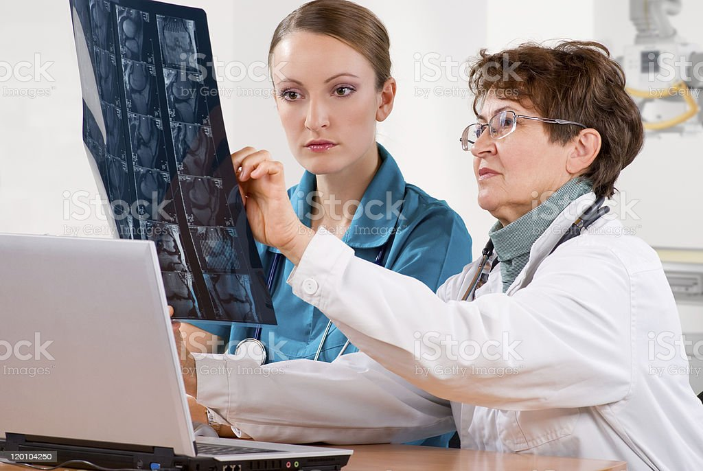 doctor teaches a student royalty-free stock photo