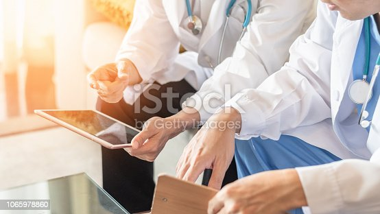 istock Doctor teamwork, orthopedic surgeon, orthopedist, ER surgery team working in hospital medical clinic office meeting room discussing on diagnostic exam on patient care operation, professional service concept 1065978860