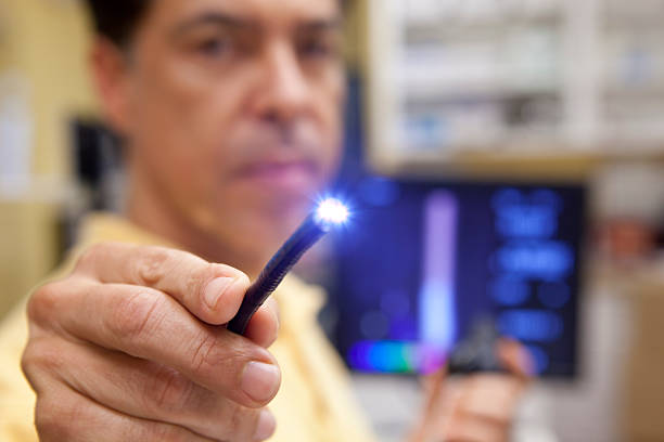 Doctor testing lighted probe used for endoscopy testing stock photo