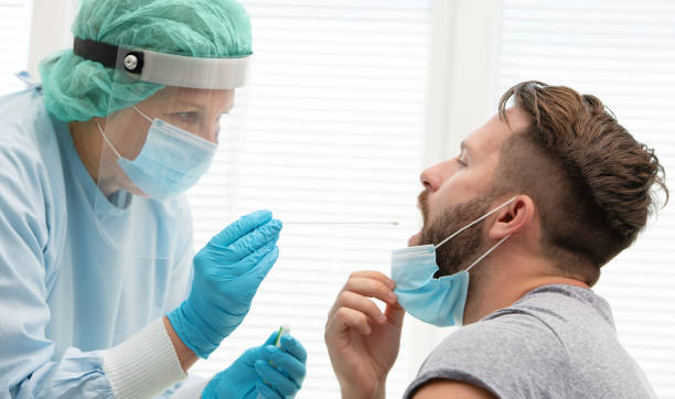 Doctor testing patient on possible coronavirus infection stock photo