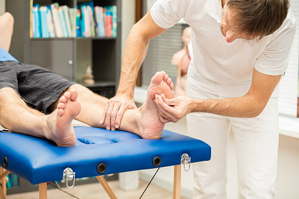 doctor testing sensibility of foot - human limb stock pictures, royalty-free photos & images