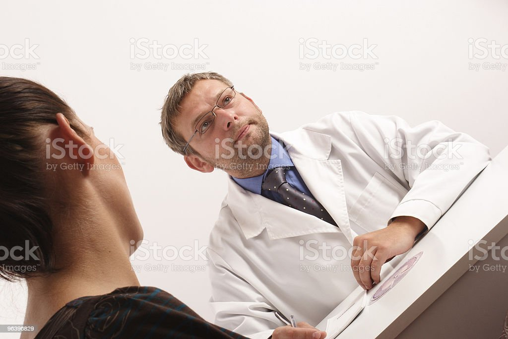 doctor thinking about diagnosis of his female patient royalty-free stock photo
