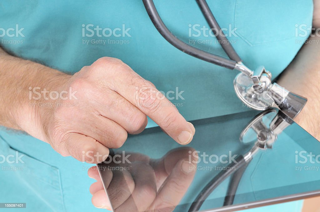 Doctor Touching Digital Tablet royalty-free stock photo