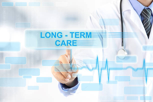 doctor touching long - term care sign on virtual screen - long stock pictures, royalty-free photos & images