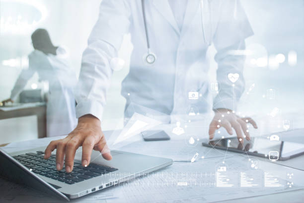 Doctor touching medical icon network connection on laptop and tablet, medical technology network concept stock photo