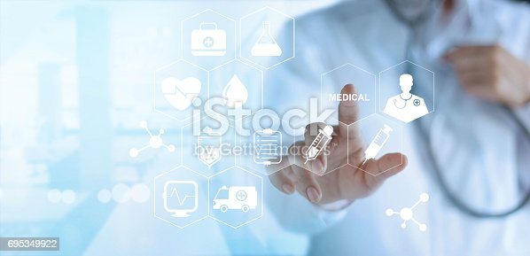845455852 istock photo Doctor touching white icon medical on virtual screen, medical technology network concept 695349922