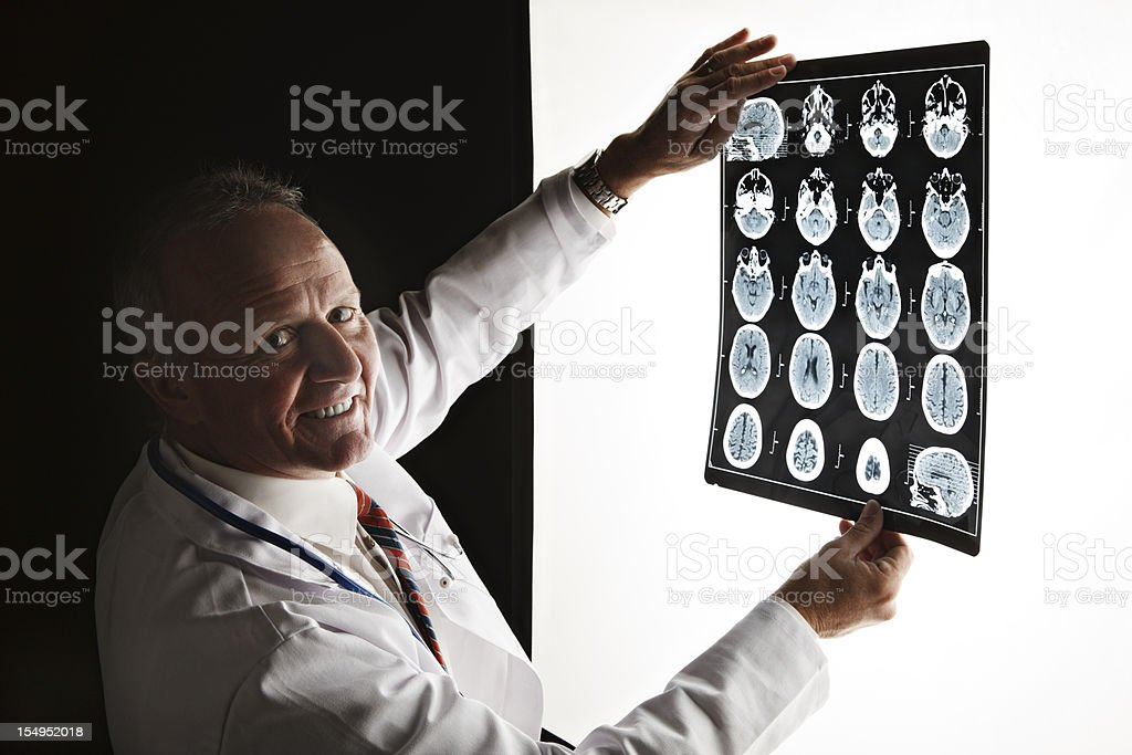 Doctor turns smiling from  CAT scan - good news! stock photo