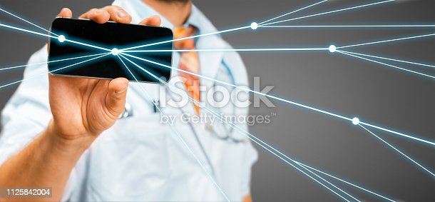 istock Doctor uses a smartphone with augmented reality. Remote diagnosis and communication with the patient doctor uses a smartphone with augmented reality. Remote diagnosis and communication with the patient 1125842004
