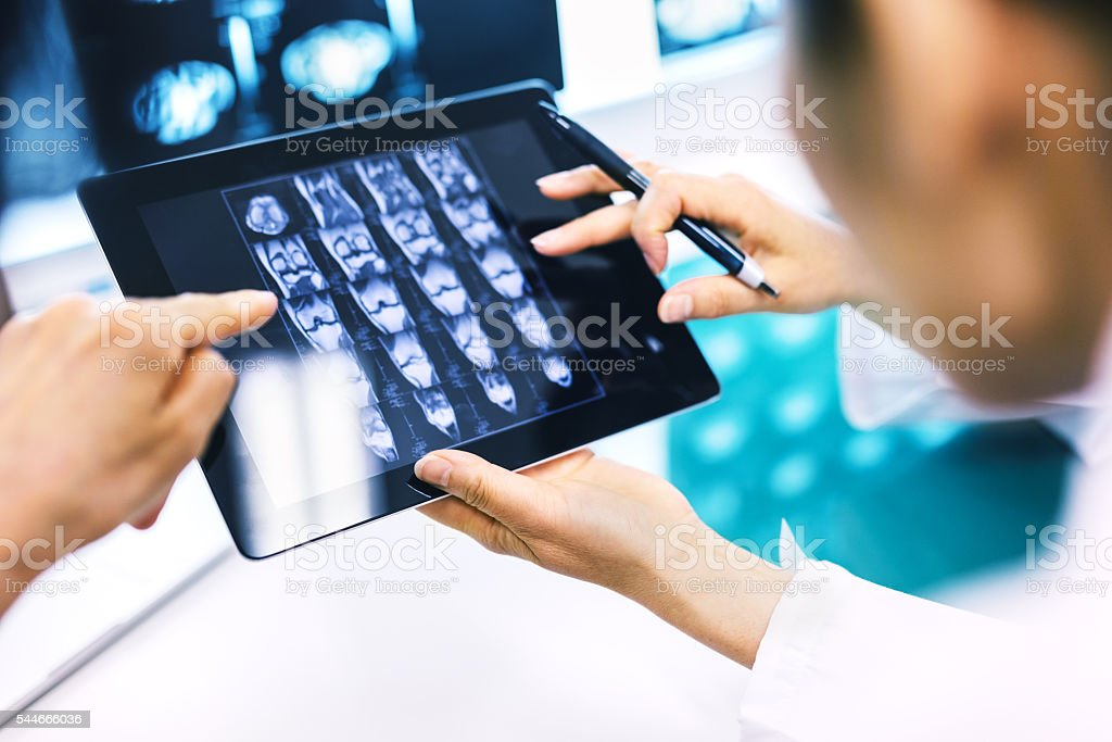 Doctor Using A Digital Tablet For His Diagnosis stock photo