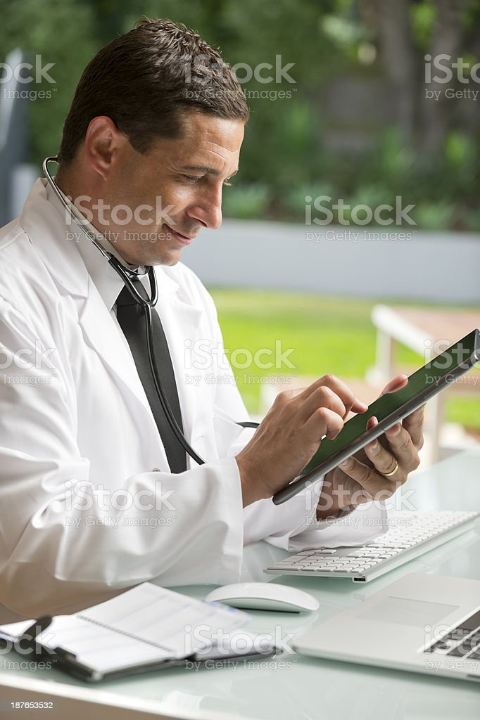 Doctor using a digital tablet royalty-free stock photo