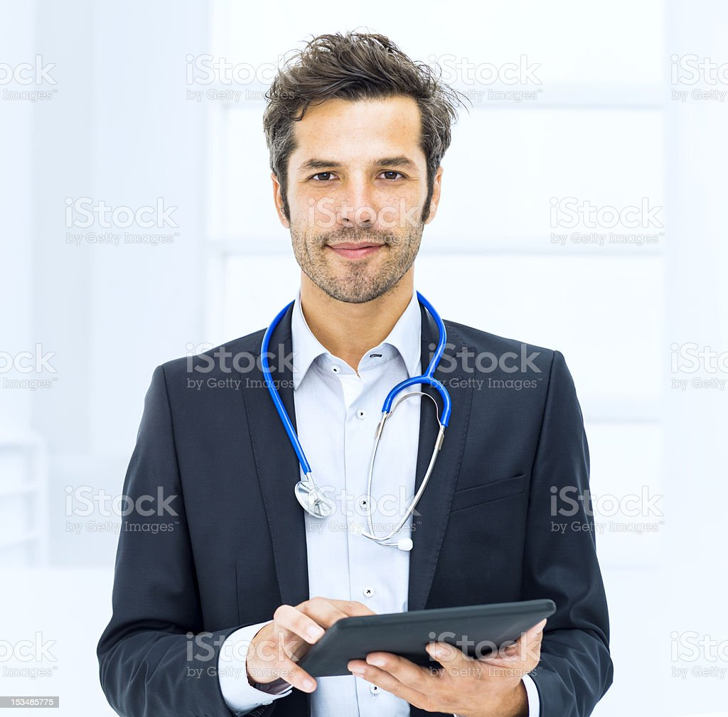 Doctor using digital tablet in hospital royalty-free stock photo