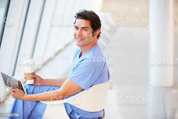 Doctor using digital tablet on coffee break in hospital picture id177844798?b=1&k=6&m=177844798&s=612x612&h=gtw4dpwpis1e vhxjzj7gpufpd44vb1lh gft1 k 64=