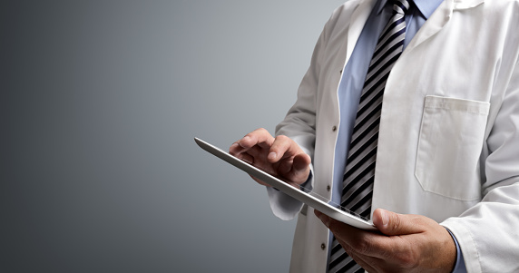 Doctor Using Digital Tablet Stock Photo - Download Image Now
