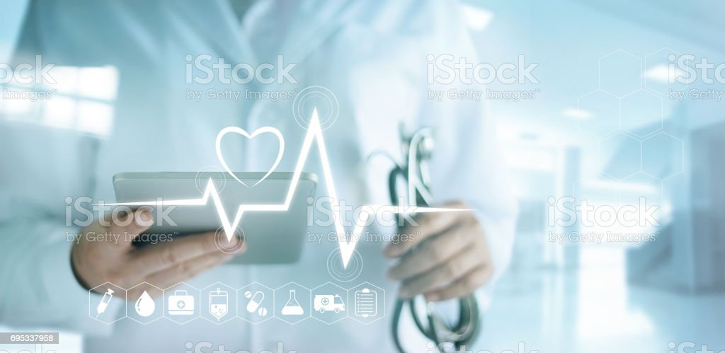 Doctor using digital tablet with medical icon and heartbeat rate in the hospital background stock photo