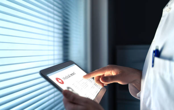 Doctor using electronic medical record (EMR) in tablet to read health care information for patient. Digital healthcare history or report. Cardiology research. stock photo