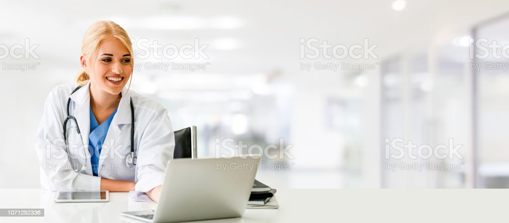 Doctor using laptop computer at the hospital. Medical healthcare and...