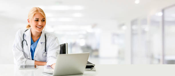 Doctor using laptop computer at the hospital. stock photo