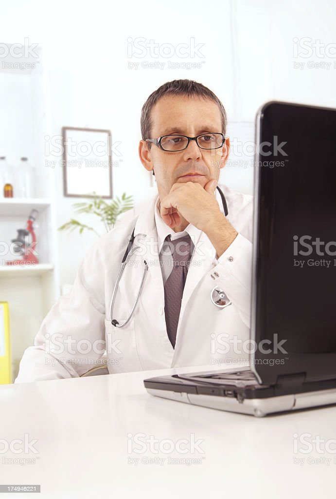 Doctor using laptop royalty-free stock photo