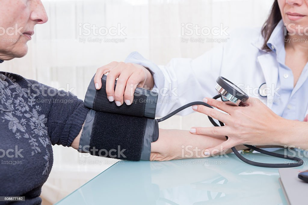 Doctor using sphygmomanometer stock photo