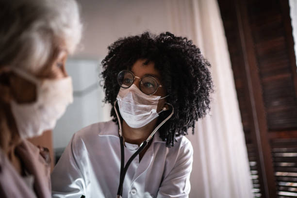 Doctor using stethoscope on a senior patient at home picture id1253858296?b=1&k=6&m=1253858296&s=612x612&w=0&h=gfwwzi7vy 0 utut8wtmu0jbsq4pvclz9aycgivea6w=
