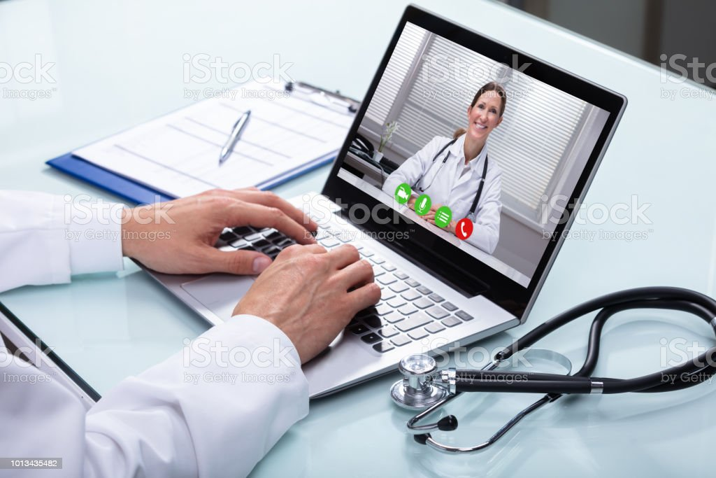 Doctor Video Conferencing On Laptop Stock Photo - Download Image Now