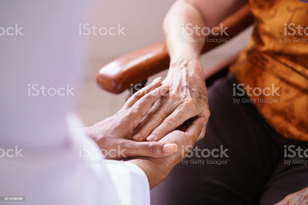 Doctor Vising Senior Woman In Old People Home stock photo