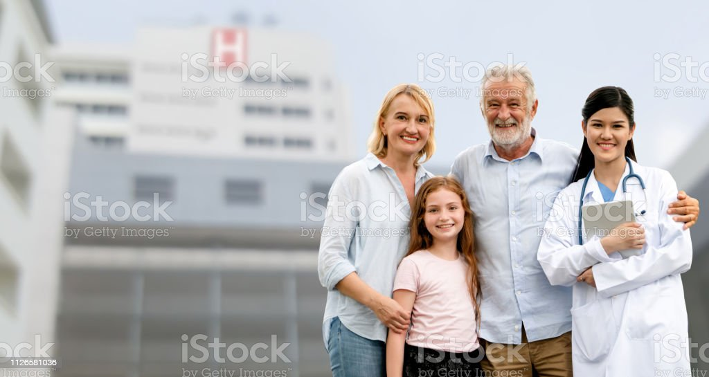 Doctor visited by family. stock photo