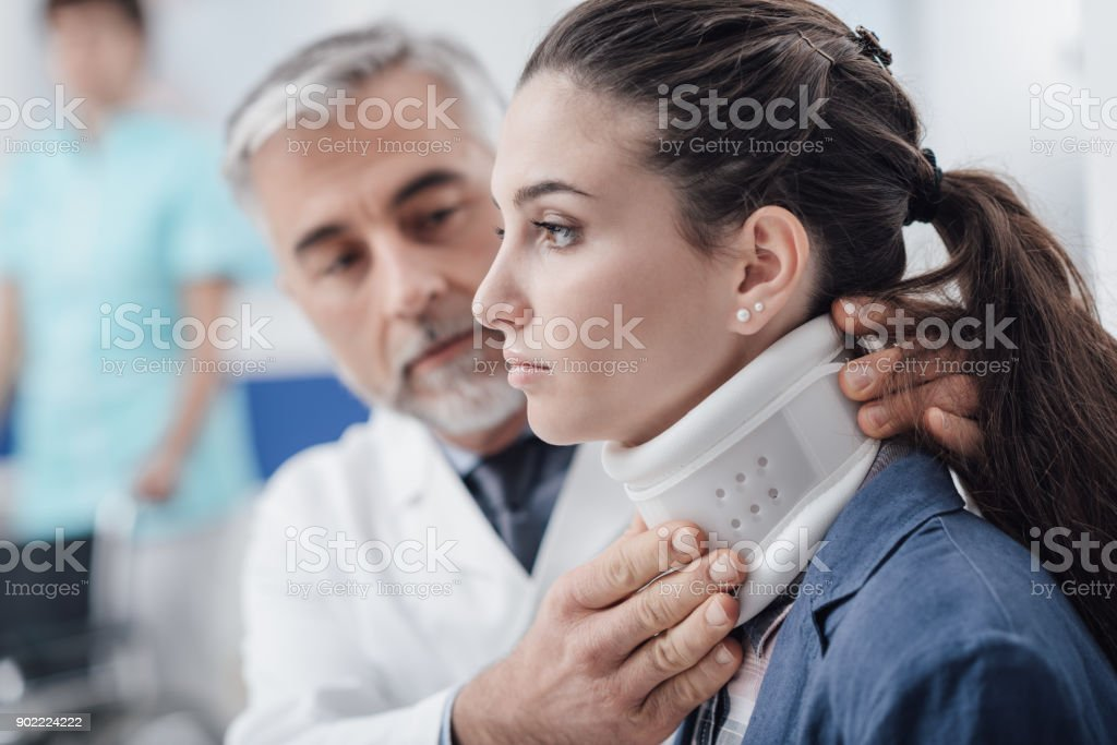 Doctor visiting a patient with cervical collar stock photo