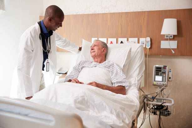 Doctor visiting and talking with senior male patient in hospital bed picture id1147976228?b=1&k=6&m=1147976228&s=612x612&w=0&h=yetewyhyhgw9z6kgs7ruk5aroupefsb0qpvmldclp60=