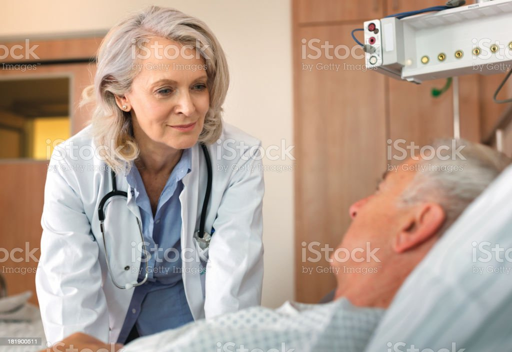 Doctor visiting patient stock photo