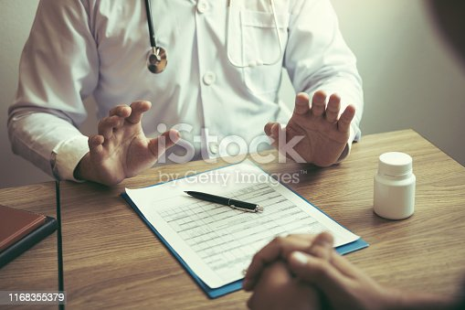1026367516istockphoto Doctor was explaining about the treatment to the patient and told him not to worry about getting sick. 1168355379