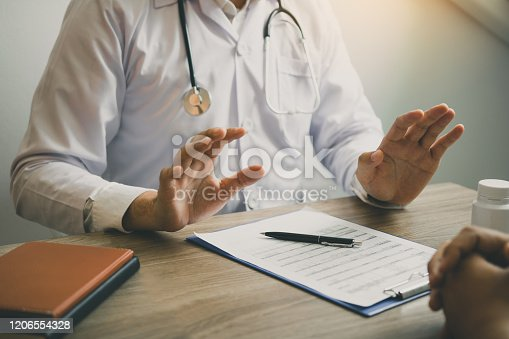 1026367516 istock photo Doctor was explaining about the treatment to the patient and told him not to worry about getting sick. 1206554328