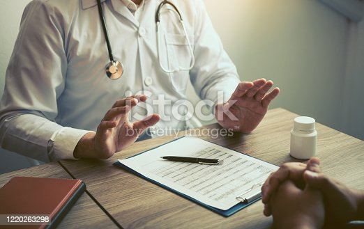1026367516 istock photo Doctor was explaining about the treatment to the patient and told him not to worry about getting sick. 1220263298