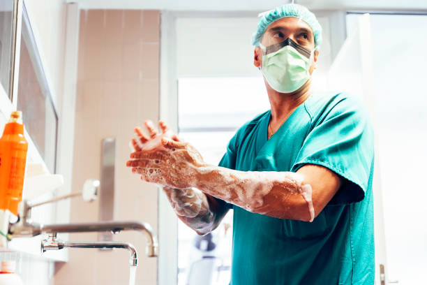 Doctor Washing Hands Before Operating. stock photo