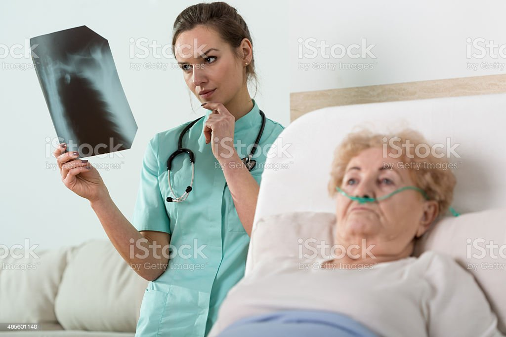 Doctor watching x-ray photography stock photo