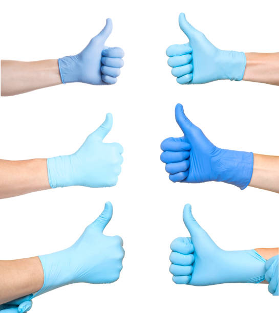 Doctor Wearing Blue Latex Glove Giving Thumbs Up Sign. Like. White background Doctor Wearing Blue Latex Glove Giving Thumbs Up Sign. Like. White background surgical glove stock pictures, royalty-free photos & images