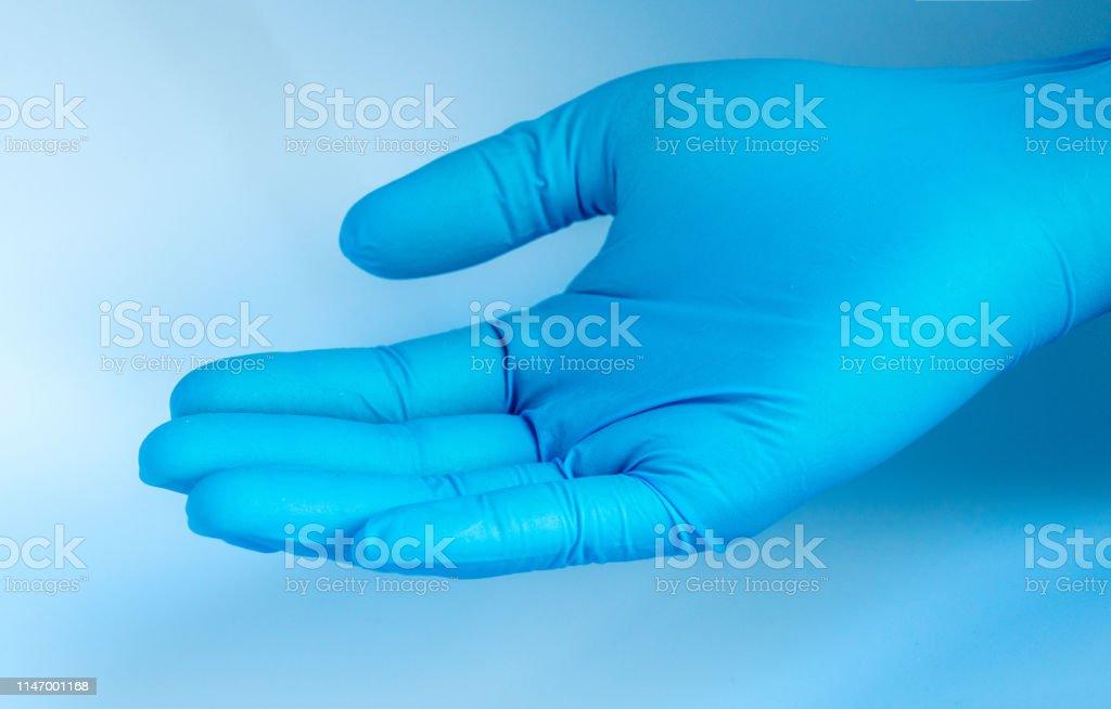 doctor wearing blue rubber glove doctor wearing blue rubber glove Blue Stock Photo