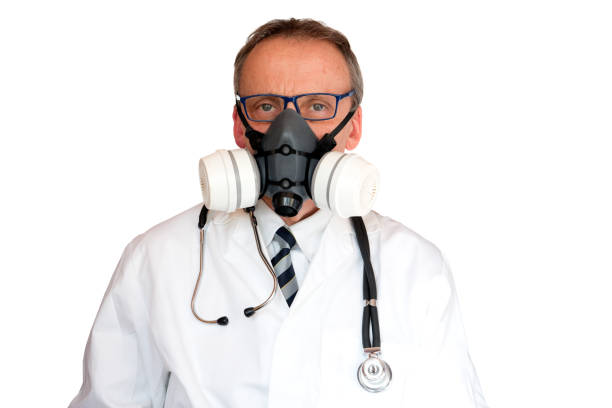 Doctor Wearing double filter Face Mask stock photo