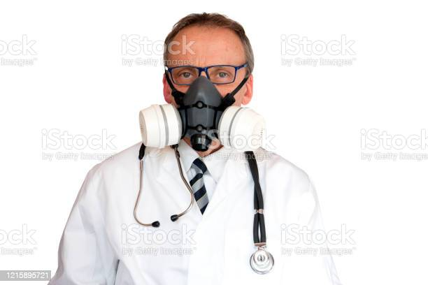 Doctor Wearing Double Filter Face Mask Stock Photo - Download Image Now