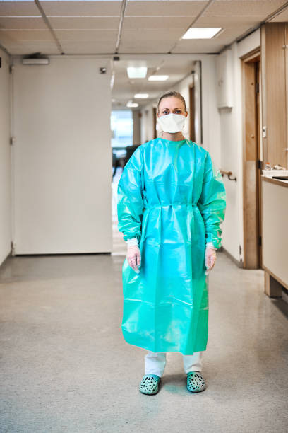 Doctor wearing face mask during covid 19 stock photo