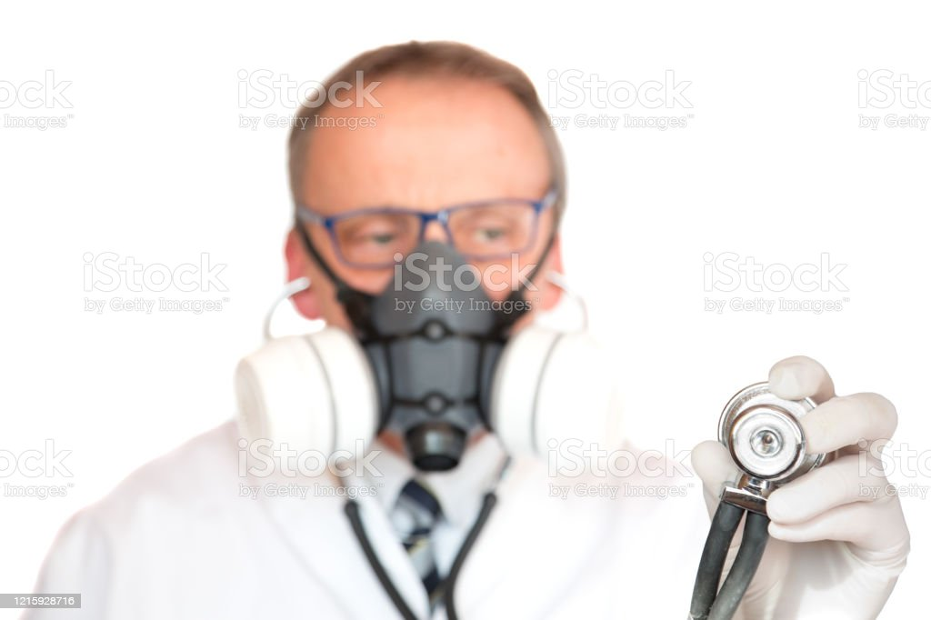 Doctor Wearing Face Mask with focus on stethoscope - Royalty-free Adult Stock Photo