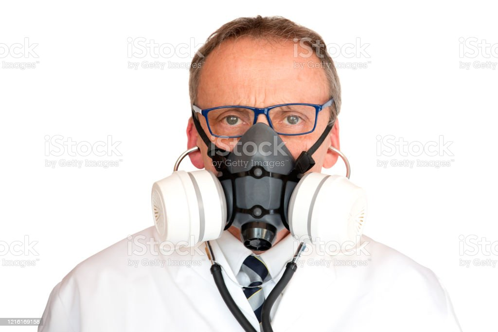 Doctor Wearing Face Mask with stethoscope in ears - Royalty-free Adult Stock Photo