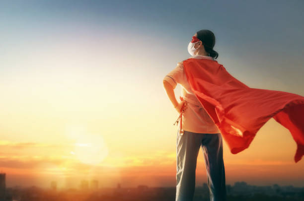Doctor wearing facemask and superhero cape stock photo