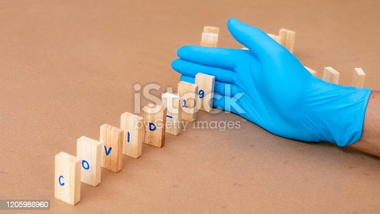 istock Doctor wearing glove stop covid-19 spreading 1205986960