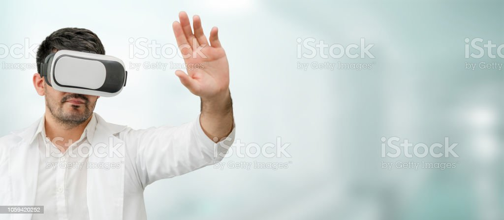 Doctor wearing VR virtual reality goggles. stock photo