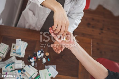 istock Doctor who prescribes medicines to a patient 534218339