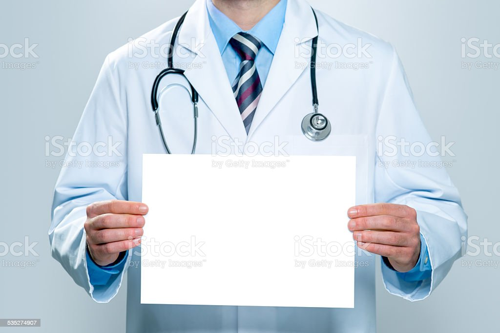 Doctor with a blank white banner stock photo