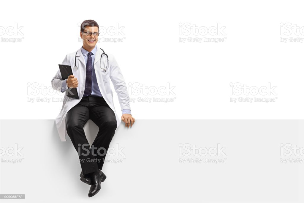 Doctor with a clipboard sitting on a panel stock photo